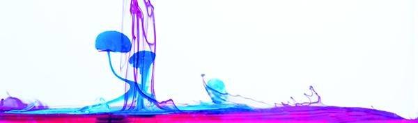 Idébild färgdroppar i vatten