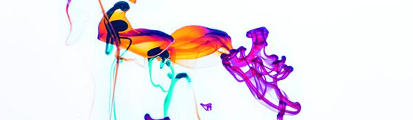 Idébild som visar färgdroppar i vatten